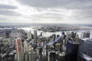 28E7E2C000000578-3089622-Bird_s_eye_view_New_York_s_Financial_District_foreground_the_Bro-a-13_1432150374932